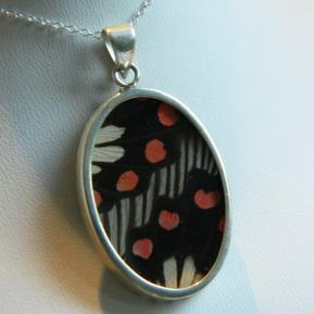 Butterfly Pendant.10.Large Vibrant Black and Red Oval.Front.JPG